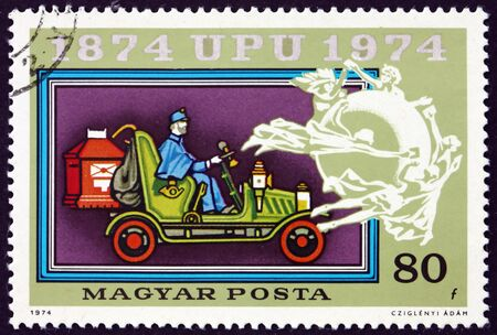 HUNGARY - CIRCA 1974: a stamp printed in Hungary shows Old Mail Automobile, UPU Emblem, Centenary of the Universal Postal Union, circa 1974