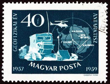HUNGARY - CIRCA 1959: a stamp printed in Hungary shows Soviet Antarctic Camp and Map of Pole, circa 1959