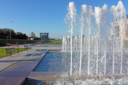 ZAGREB, CROATIA - JULY 4, 2014: A view of City Park with Fountains and Street Croatian Fraternal Union, Zagreb, Croatia