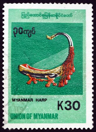 BURMA - CIRCA 1998: a stamp printed in the Burma shows harp, musical instrument, circa 1998