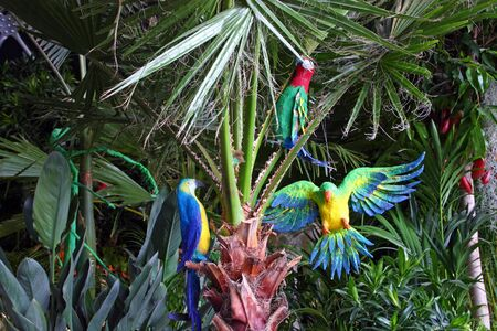 ZAGREB, CROATIA - MAY 18, 2019: parrots in treetops, garden decoration exposed on Floraart, 54. International Garden Exhibition, Zagreb, Croatia