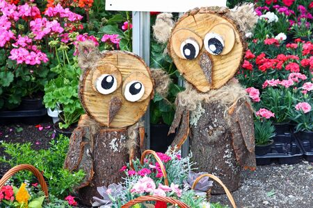 ZAGREB, CROATIA - MAY 18, 2019: Two wooden birds, garden decoration exposed on Floraart, 54. International Garden Exhibition, Zagreb, Croatia 新聞圖片