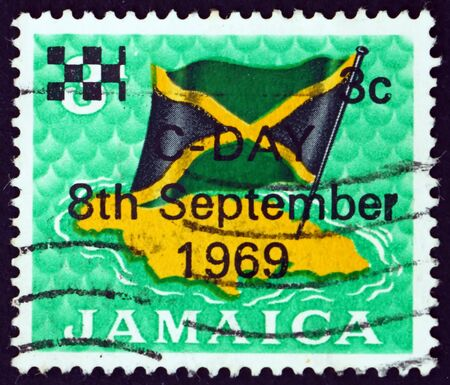 JAMAICA - CIRCA 1969: a stamp printed in Jamaica shows flag over map of Jamaica, circa 1969