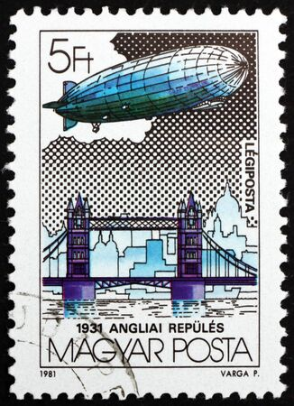 HUNGARY - CIRCA 1981: a stamp printed in Hungary shows Graf Zeppelin over Tower Bridge, England, circa 1981