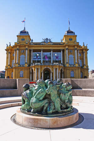 ZAGREB, CROATIA - JULY 28, 2020: Well of Life sculpture, by Mestrovic, in front of the Croatian national theater  in Zagreb, Croatia