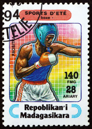 MALAGASY - CIRCA 1994: a stamp printed in Malagasy, Madagascar shows boxing, sport, circa 1994