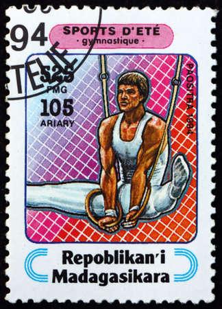 MALAGASY - CIRCA 1994: a stamp printed in Malagasy, Madagascar shows gymnastics, sport, circa 1994