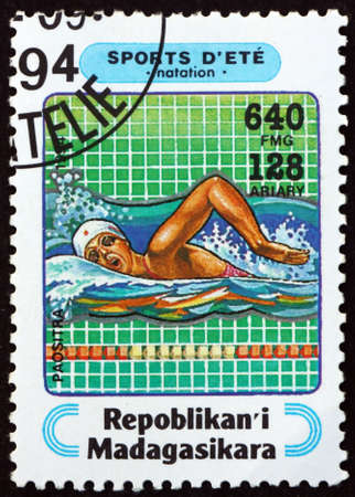 MALAGASY - CIRCA 1994: a stamp printed in Malagasy, Madagascar shows swimming, sport, circa 1994