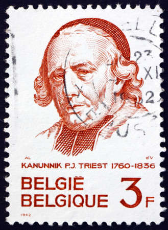 BELGIUM - CIRCA 1962: a stamp printed in Belgium shows Canon Pierre-Joseph Triest (1760-1836), educator and founder of hospitals and orphanages, circa 1962
