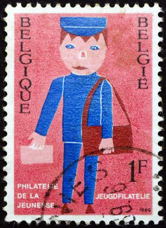 BELGIUM - CIRCA 1969: a stamp printed in Belgium shows mailman, youth philately, circa 1969 Editorial