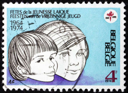 BELGIUM - CIRCA 1974: a stamp printed in Belgium shows children, 10th Lay youth festival, circa 1974 Editorial