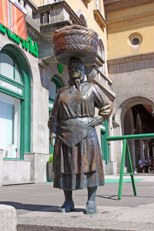 Statue of countrywoman with woven basket on her head on Dolac market in Zagreb, Croatia