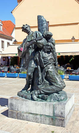 ZAGREB, CROATIA - JULY 28, 2020: Sculpture of Petrica Kerempuh, literary figure, placed on a little square next to Dolac, Zagreb, Croatia