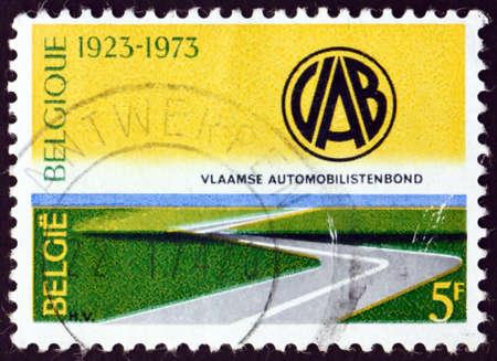 BELGIUM - CIRCA 1973: a stamp printed in Belgium shows highway and automobile club emblem, Flemish automobile club, circa 1973