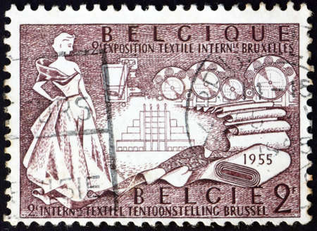 BELGIUM - CIRCA 1955: a stamp printed in Belgium shows allegory of textile manufacture, 2nd international textile exhibition, Brussels, circa 1955