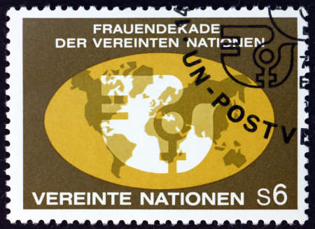 UNITED NATIONS - CIRCA 1980: a stamp printed in the United Nations, offices in Vienna shows womens year emblem on world map, UN decade for women, circa 1980