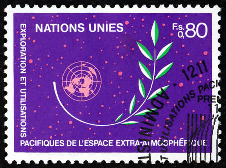 UNITED NATIONS - CIRCA 1983: a stamp printed in the United Nations, offices in Geneva shows olive branch in outer space and UN emblem, circa 1983 新闻类图片