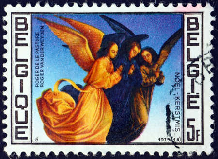 BELGIUM - CIRCA 1975: a stamp printed in Belgium shows Angels, by Rogier van der Weyden, an Early Netherlandish painter, circa 1975 新闻类图片