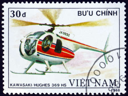 VIETNAM - CIRCA 1988: a stamp printed in Vietnam shows Kawasaki Hughes 369HS, is a light utility helicopter, built under licence by Kawasaki Heavy Industries in Japan, circa 1988