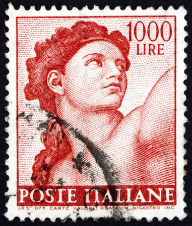 ITALY - CIRCA 1961: a stamp printed in Italy shows Eve, detail from Sistine Chapel by Michelangelo, circa 1961 Stok Fotoğraf