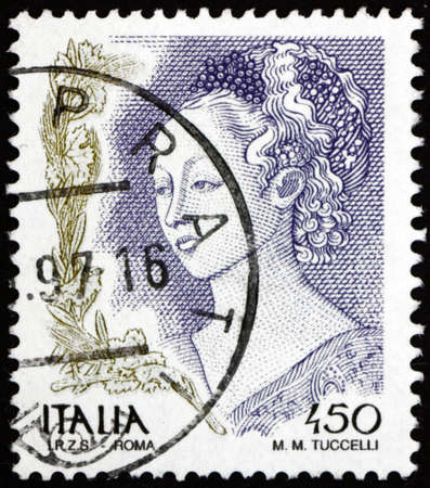 ITALY - CIRCA 1998: a stamp printed in Italy shows woman portrait, detail from Herods Feast, painting by Filippo Lippi, circa 1998