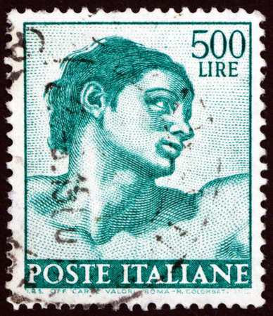ITALY - CIRCA 1961: a stamp printed in Italy shows Adam, detail from Sistine Chapel by Michelangelo, circa 1961