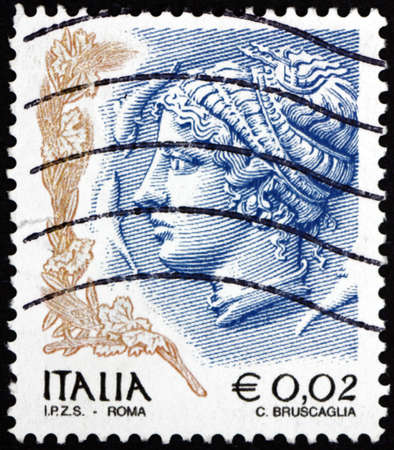 ITALY - CIRCA 2002: a stamp printed in Italy shows profile of woman from Syracuse, tetradrachm, circa 2002