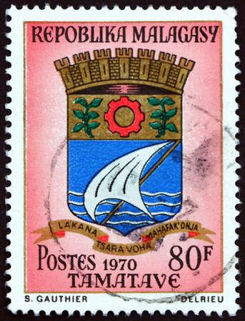 MALAGASY - CIRCA 1970: a stamp printed in Malagasy, Madagascar shows Tamatave, Coat of Arms, circa 1970