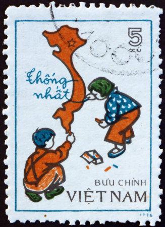 VIETNAM - CIRCA 1977: a stamp printed in Vietnam shows children drawing map of unified Viet Nam, circa 1977