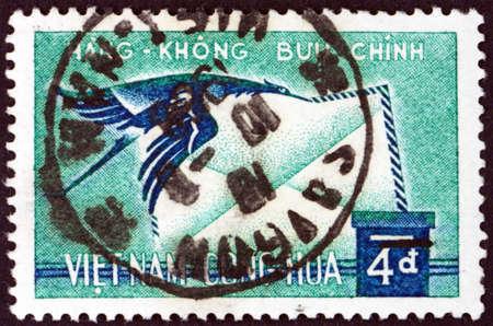 VIETNAM - CIRCA 1960: a stamp printed in Vietnam shows crane carrying letter, circa 1960