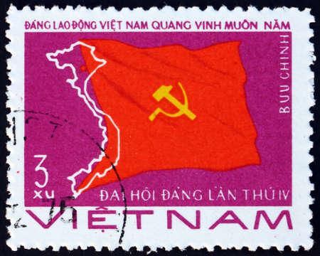 VIETNAM - CIRCA 1976: a stamp printed in Vietnam shows flag, Vietnam Worker