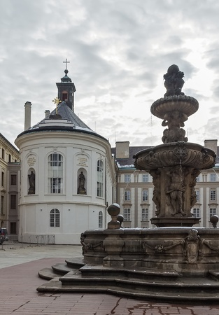 rood: Church of the Holy Rood and Fountain in Prague castle Stock Photo