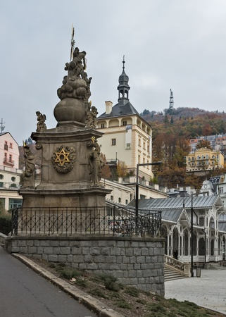 vary: Holy Trinity Column and Castle Tower in Karlovy Vary Editorial