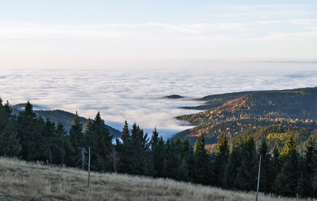 Kind from mountain on the sea from a fog over area of Karlovy Vary photo