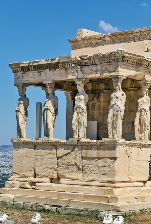 The Erechtheion is an ancient Greek temple on the north side of the Acropolis of Athens in Greece which was dedicated to both Athena and Poseidon. photo