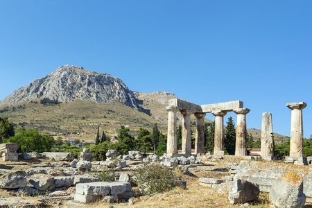 The ruins of the Temple of Apollo in ancient Corinth, Greece photo