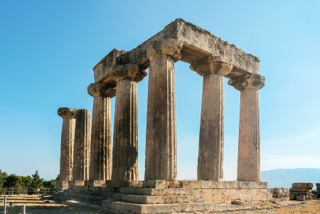 The ruins of the Temple of Apollo in ancient Corinth, Greece Stock Photo