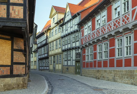 the street with half-timbered houses in Quedlinburg, Germany. In downtown a wide selection of half-timbered buildings from at least five different centuries are to be found photo