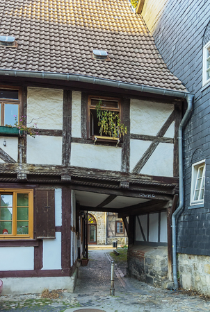 gate in the old half-timbered house in Quedlinburg, Germany photo