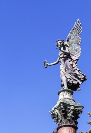 Angel Statue. One of two statues that are facing each other near the entrance to the garden of Charlottenburg Palace, Berlin Standard-Bild