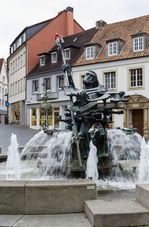 settles: Neptune fountain settles down near Paderborn cathedral, Germany