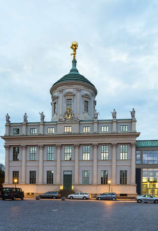 settles: Old Town Hall settles down on a old market square of Potsdam, Germany
