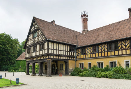 half timbered: Cecilienhof is a palace in Potsdam, Brandenburg, Germany. Cecilienhof was the last palace built by the Hohenzollern family that ruled Prussia and Germany until 1918.
