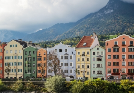 colorful houses on the waterfront of the River Inn in Innsbruck, Austria photo