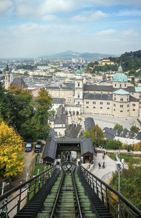 views of the historic centre of Salzburg with the funicular to Hohensalzburg Castle, Austria photo