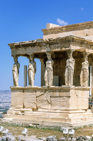 caryatids: The Erechtheion is an ancient Greek temple on the north side of the Acropolis of Athens in Greece which was dedicated to both Athena and Poseidon. Stock Photo