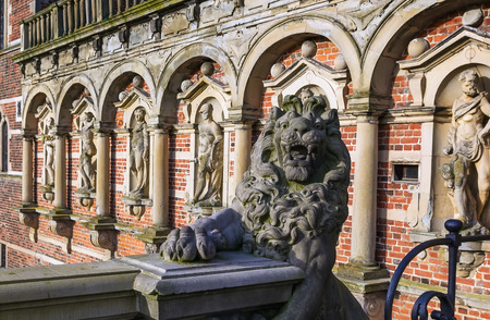 sculpture of a lion in front of the Frederiksborg Palace in\ Hillerod, Denmark.