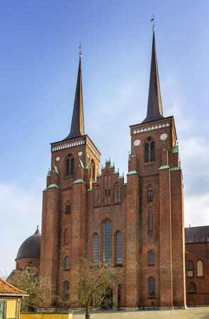 encouraged: Roskilde Cathedral is a cathedral of the Lutheran Church of Denmark.  The first Gothic cathedral to be built of brick, it encouraged the spread of the Brick Gothic style throughout Northern Europe.
