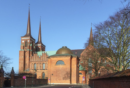 the throughout: Roskilde Cathedral is a cathedral of the Lutheran Church of Denmark.  The first Gothic cathedral to be built of brick, it encouraged the spread of the Brick Gothic style throughout Northern Europe.