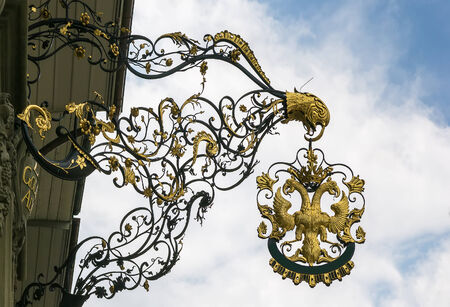 doubleheaded: Signboard with double-headed eagle on house in Bern city, Switzerland Stock Photo